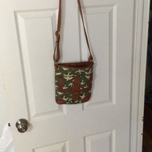 Green patterned canvas and leather cross body bag